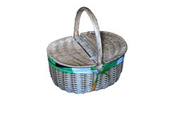The wicker picnic basket. The picnic basket from wicker on the white background Stock Image