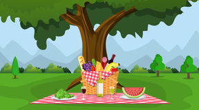 WIcker picnic basket full of products. Royalty Free Stock Image