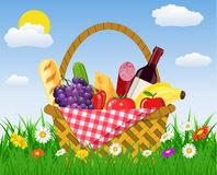 WIcker picnic basket full of products. Royalty Free Stock Photos