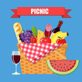 WIcker picnic basket. With gingham blanket full of products. Bottle of wine, sausage, bacon, cheese, apple, tomato, cucumber. Vector illustration in flat style stock illustration