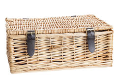 Wicker picnic basket with leather brass buckled straps. Isolated on white Stock Photo