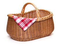Wicker picnic basket with red checked napkin. Wicker picnic basket with red checked napkin, isolated on the white background Royalty Free Stock Photography