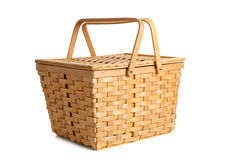 Wicker picnic basket on white Royalty Free Stock Images