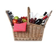 Wicker picnic basket with wine and different products. On white background royalty free stock photography