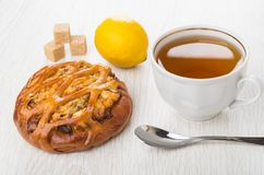 Wicker pie with chicken stuffed, cup of tea, lemon, sugar Stock Photography
