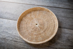Wicker placemat on wooden Stock Photo