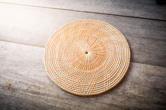 Wicker placemat on wooden Royalty Free Stock Image