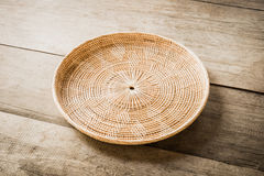 Wicker placemat on wooden table Stock Photo