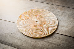 Wicker placemat on wooden table Royalty Free Stock Photos