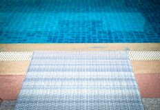 Wicker rattan pool sun bed deckchair at swimming pool. Wicker rattan pool sun bed deckchair at poolside of swimming pool. summer holiday vacation royalty free stock images