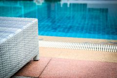 Wicker rattan pool sun bed deckchair at swimming pool. Wicker rattan pool sun bed deckchair at poolside of swimming pool. summer holiday vacation stock photos