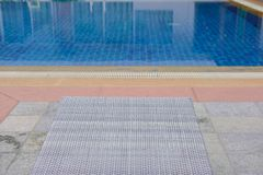 Wicker rattan pool sun bed deckchair at swimming pool. Wicker rattan pool sun bed deckchair at poolside of swimming pool. summer holiday vacation royalty free stock photography