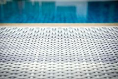 Wicker rattan pool sun bed deckchair at swimming pool. Wicker rattan pool sun bed deckchair at poolside of swimming pool. summer holiday vacation stock photography