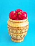 Wicker with red apples. Fruit-piece. wattled vase with red apples on blue background Stock Photography