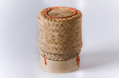 Wicker on rice. Hand craft handmade bamboo weaving Thai sticky rice round box on a colorful reed mat for sale in a traditional lifestyle village Stock Photography
