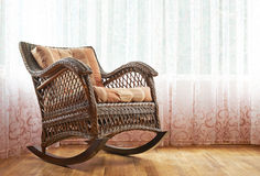 Wicker rocking chair composition Stock Images