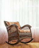 Wicker rocking chair composition Royalty Free Stock Photography