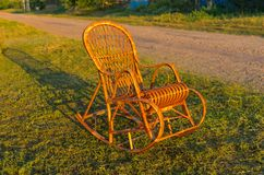 Wicker rocking-chair Stock Images
