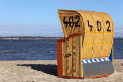 Wicker roofed beach chair. Standing on the beach Stock Images