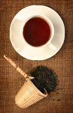 A wicker scoop with herb tea leaves Stock Images