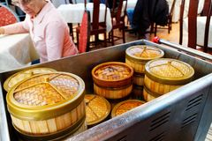 A trolley of food in a dim sum restaurant royalty free stock photos