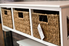 Wicker shelf boxes. A home decoration and furniture - white shelf with three wicker boxes or organizers Royalty Free Stock Photography