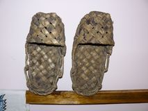 Wicker shoes bast shoes. Bast shoes on a stand. Wicker shoes bast shoes. Bast shoes on a stand Stock Photo