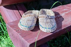 Wicker shoes on doorstep at sunny weather. Wicker shoes on wooden doorstep at sunny summer weather for comfort Stock Photos