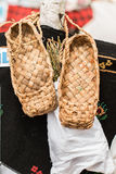 The wicker shoes of the rural population of Russia. Called bast shoes Royalty Free Stock Photos