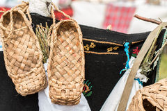 The wicker shoes of the rural population of Russia. Called bast shoes Stock Photos