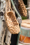 The wicker shoes of the rural population of Russia. Called bast shoes Stock Photography
