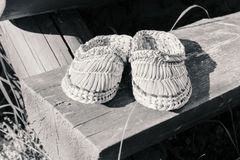 Wicker shoes on wooden doorstep. At sunny summer weather in sepia Royalty Free Stock Images