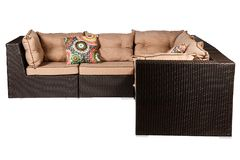 Wicker sofa with linen cushions in sand color. Wicker sofa with linen cushions in a sand color royalty free stock photo