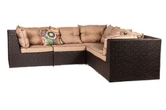 Wicker sofa with linen cushions in sand color. Wicker sofa with linen cushions in a sand color stock photos