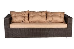 Wicker sofa with linen cushions in sand color. Wicker sofa with linen cushions in a sand color stock photo