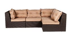 Wicker sofa with linen cushions in sand color. Wicker sofa with linen cushions in a sand color royalty free stock image