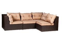 Wicker sofa with linen cushions in sand color. Wicker sofa with linen cushions in a sand color stock image
