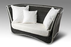 Wicker sofa with pillows Stock Photography