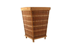 Wicker Storage Basket. An isolated over white wicker storage basket, brown and light brown in color with wood borders.  Rustic Stock Image