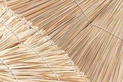 Wicker straw umbrellas closeup background Stock Photos