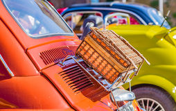 Wicker suitcase on luggage rack. Of ancient Italian subcompact red car Stock Images