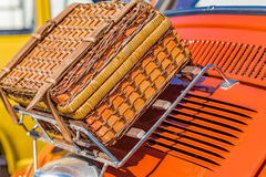 Wicker suitcase on luggage rack. Of ancient Italian subcompact red car Stock Image