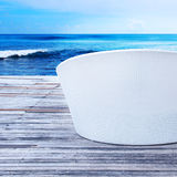 Wicker sunbed on a sea background Royalty Free Stock Photo