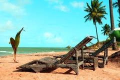 Wicker sunbeds on beach Royalty Free Stock Photo
