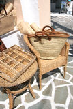 Wicker table, chair, bag and small mats Royalty Free Stock Photo