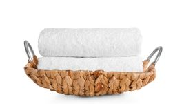 Wicker tray with clean soft towels. On white background royalty free stock photos