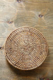 Wicker tray on plywood Royalty Free Stock Images