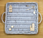 Wicker tray and wooden figures Stock Photography