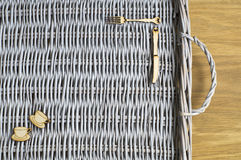 Wicker tray and wooden figures Royalty Free Stock Photos