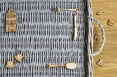 Wicker tray and wooden figures Stock Image